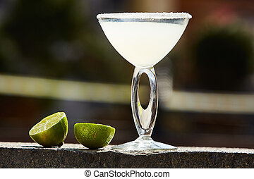 Cocktail in margarita glass with limes. Shallow dof
