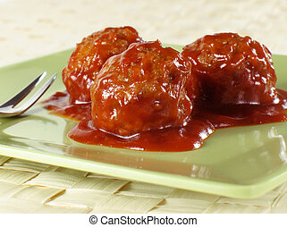 Cocktail Meatballs - Meatballs smothered in barbecue sauce.