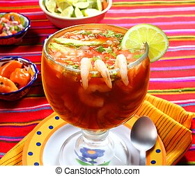 Cocktail of shrimps seafood mexican style chili sauce lemon