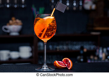 Cocktail on the bar with orange