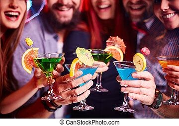 Cocktail party - Boozing friends cheering up with cocktails...