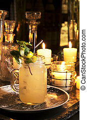 Cocktail serve on table with candle decoration background