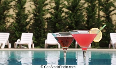 Cocktail - Two Glasses Filled With A Summer Drink In The...