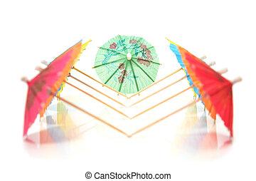 cocktail umbrellas in a row