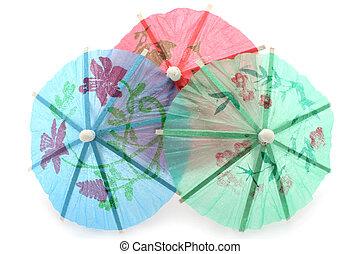 Cocktail umbrellas on a white background