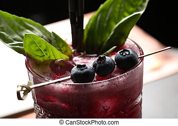 Cocktail with a berries. Close up - Blueberries on a skewer,...
