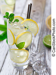 Cocktail with ice and lemon slices isolated on white ...