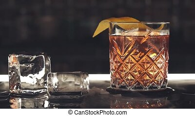 Cocktail with ice cubes on the bar