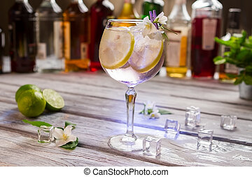 Cocktail with lemon in glass.