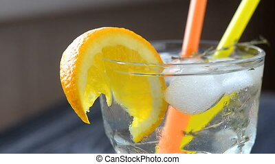Cocktail with orange slice and ice