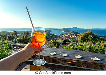 cocktail with scenic view of the croatian losinj islands in ...