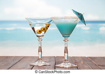 Cocktails on the sea background