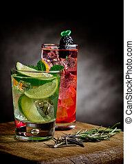 Refreshing citrus cocktails on black background