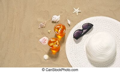 cocktails, sun hat and sunglasses on beach sand - vacation,...