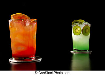 Cocktails - Two designer cocktails isolated on black ...
