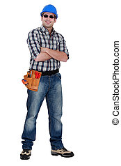 Cocky laborer posing on white background