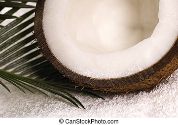 coco bath. coconut, towel anh palm leaf. exotic scene