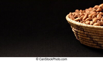 Cocoa beans - Basket of cocoa beans spills over