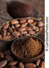 Cocoa beans in the dry cocoa pod fruit on wooden background...