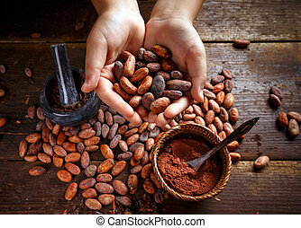 Cocoa beans - Hand holding aromatic cocoa beans, closeup