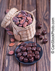 cocoa beans on the wooden table, dry cocoa beans