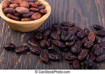 Cocoa beans on a wooden table