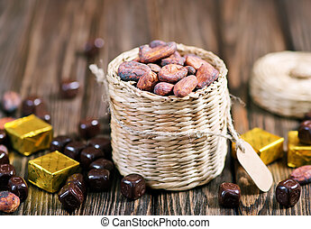 cocoa beans - cocoa  on the wooden table, cocoa beans