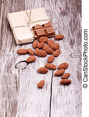 Cocoa nuts and Chocolate background - Cocoa nuts on a wooden...