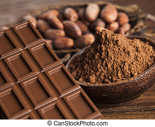 Cocoa pod and chocolate bar and food dessert background -...