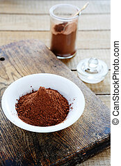 cocoa powder in a bowl and jar