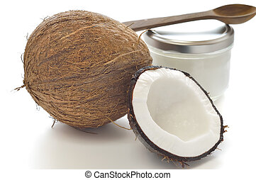Coconut and organic coconut oil in a glass jar on white...