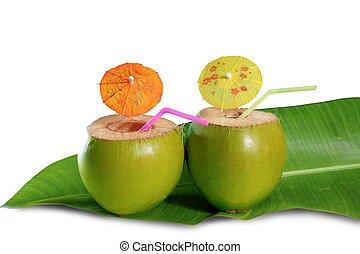 coconut beverage straw cocktail on banana tree leaf - ...