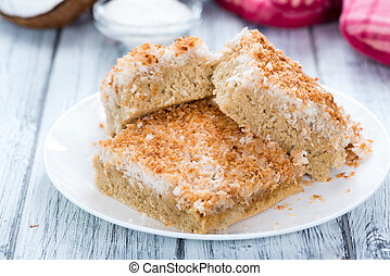 Coconut Cake (detailed close-up shot) on wooden background