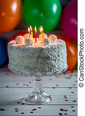 Coconut cake with candles on birthday