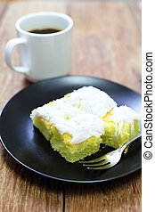coconut cake with coffee on wood table