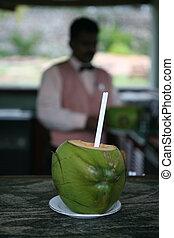 Coconut cocktail - A waiter serving cocktails made inside ...