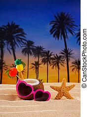 Coconut cocktail on tropical sand beach heart sunglasses