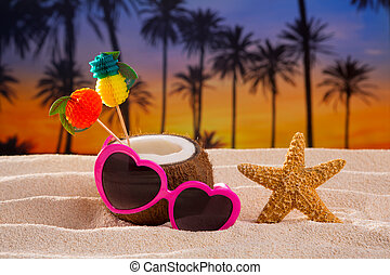 Coconut cocktail on tropical  sand beach heart sunglasses