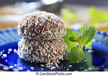 Coconut confections - Chocolate coconut confections filled...