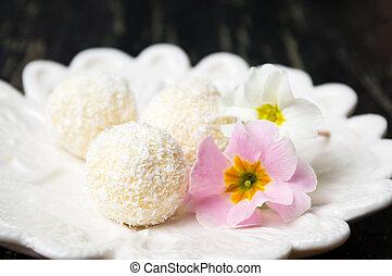 Coconut dessert balls on a plate