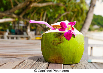 Coconut drink on the wooden table