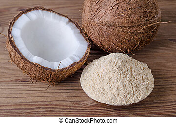 coconut flour in a bowl on wooden background