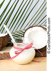Coconut fruit and milk in a bottle
