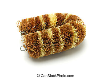 Cleaning brush made from coconut husk on white background