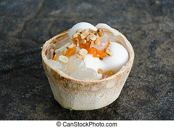 Coconut ice cream in Coconut shell.