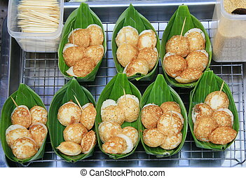 Coconut milk mix with powder fried dessert in banana leave, thai food