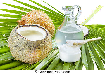 Coconut oil. - Liquid and solid coconut oil on palm leaf .