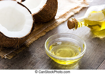 Coconut oil on wooden background