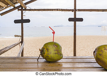 coconut on the table against the background of the sea