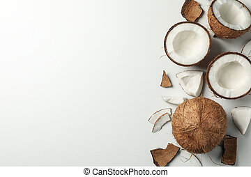 Coconut on white background, top view and space for text